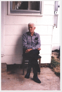 Miles Gregory. Sitting on the back patio. Early '90s.